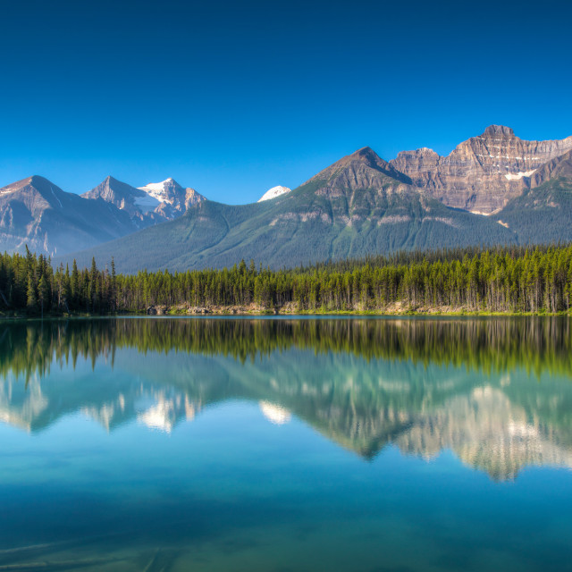 """Mountains reflecting on a lake"" stock image"