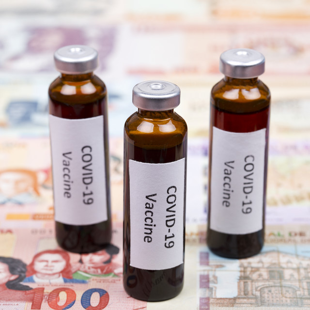 """Vaccine against Covid-19 on the background of Bolivian money"" stock image"