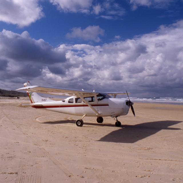 """Light plane on Fraser Island Beach"" stock image"