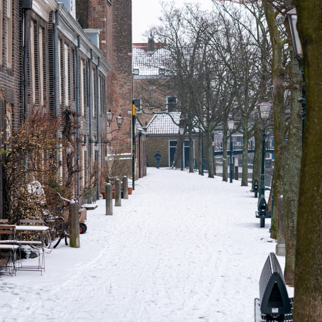 """""""Snow on the ground on Pottenkade in historical Dordrecht"""" stock image"""