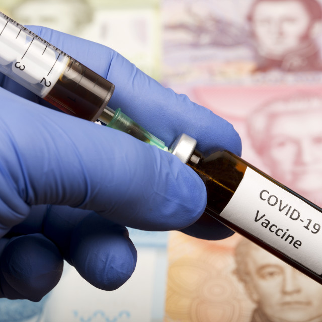 """Vaccine against Covid-19 on the background of Chilean money"" stock image"