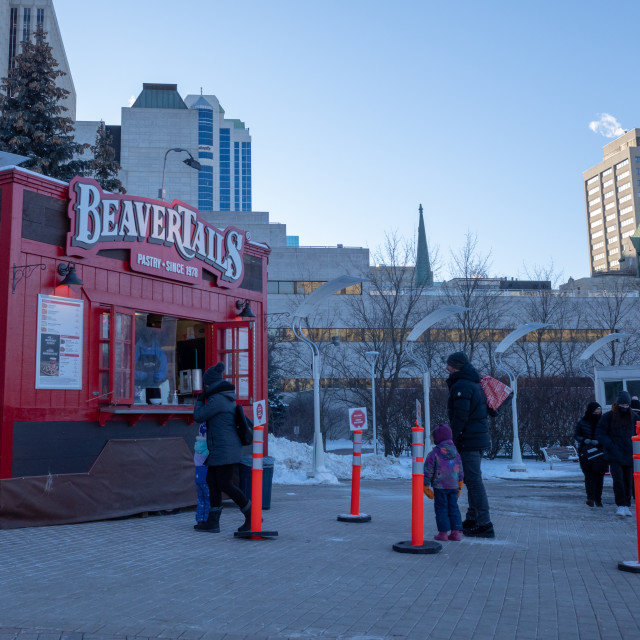 """""""Physical Distancing Queue at BeaverTails in Ottawa"""" stock image"""