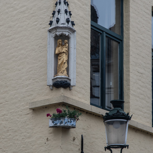 """Madonna & child shrine, house corner, Brugge"" stock image"
