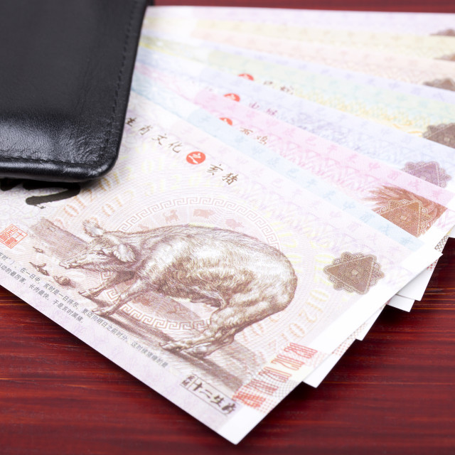"""Chinese money in the black wallet"" stock image"