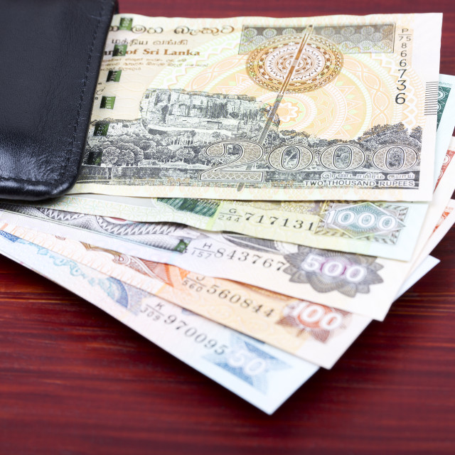 """Old Sri Lankan money in the black wallet"" stock image"