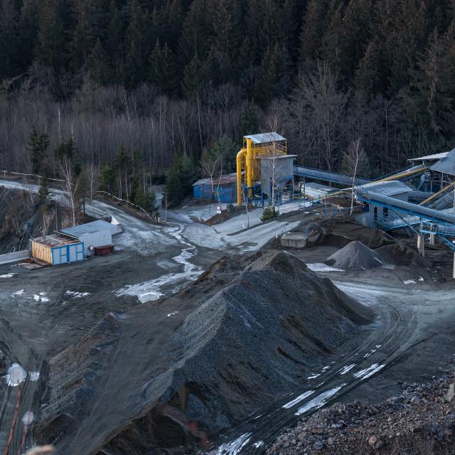 """Mining in a granite quarry Sloupno, Czech republic."" stock image"