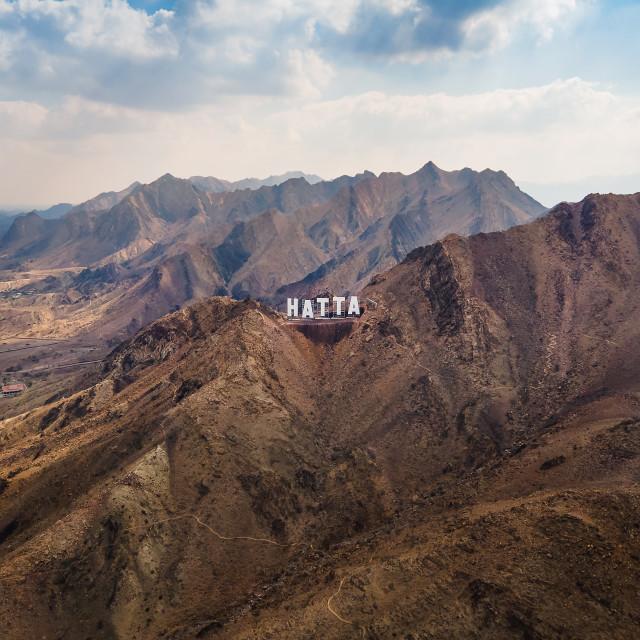 """Hatta city sign in Hajar mountains in Hatta enclave of Dubai in"" stock image"