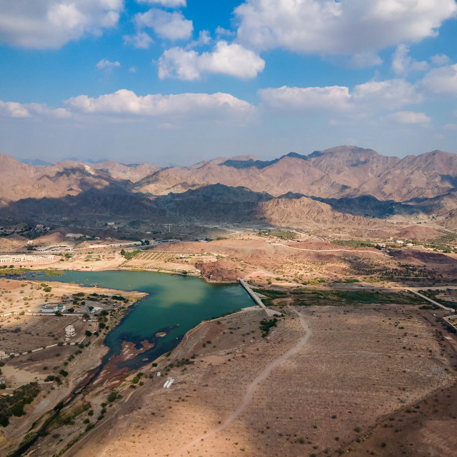 """""""Hatta town aerial cityscape surrounded by Hajar mountains in Hat"""" stock image"""