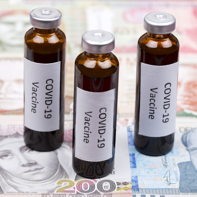 """Vaccine against Covid-19 on the background of Peruvian money"" stock image"