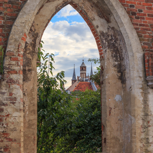 """City view trough a window of the Teutonic castle ruins in Torun, Poland"" stock image"