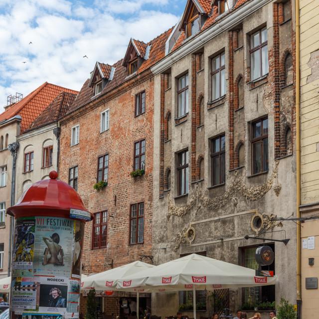 """Street view in Torun with an outdoors terrace, Poland"" stock image"