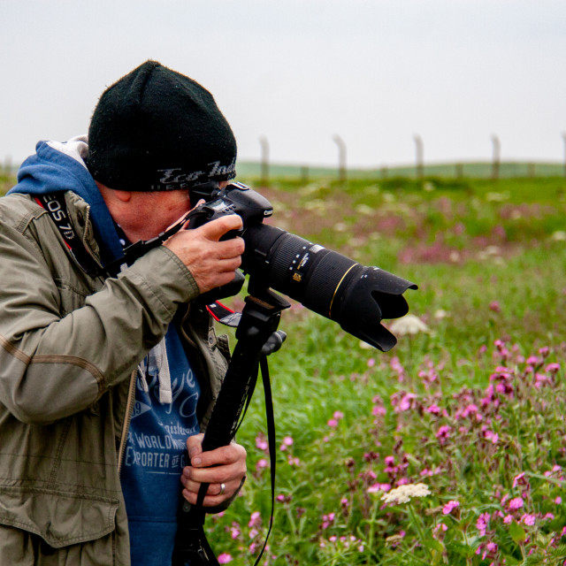 """Nature Photographer on Cliff Top at Bempton Cliffs RSPB Reserve, Yorkshire, England"" stock image"