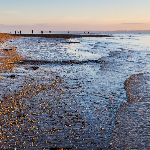 """""""Gentle waves from the receding tide lap the gravel beach at Meon"""" stock image"""