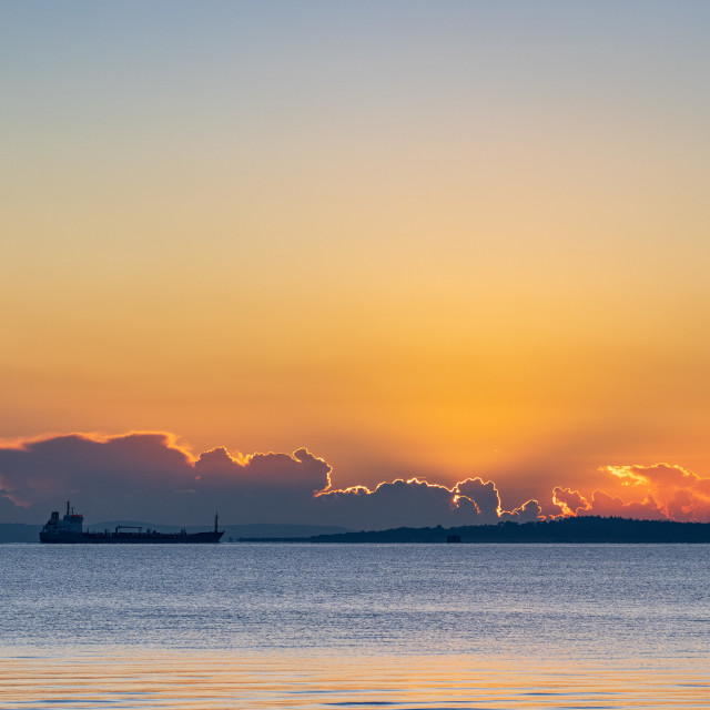 """""""Sunset and oil tanker"""" stock image"""