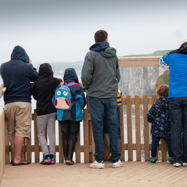 """Bird Watchers (rear view) at Bempton Cliffs RSPB Reserve. Yorkshire, England."" stock image"