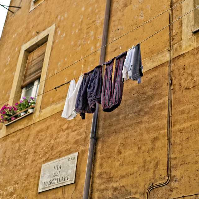 """Washing hanging above a street in Rome"" stock image"