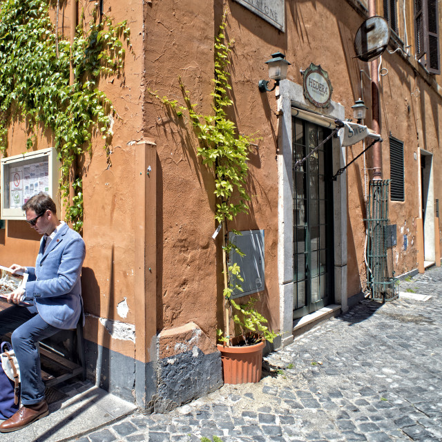 """Sunny morning scene outside a bar in Rome"" stock image"