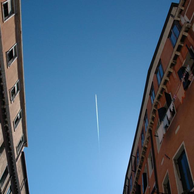 """Venetian buildings, jet contrail"" stock image"