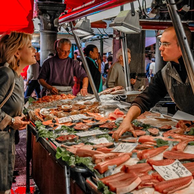 """Fishmonger & customer, Rialto Market"" stock image"