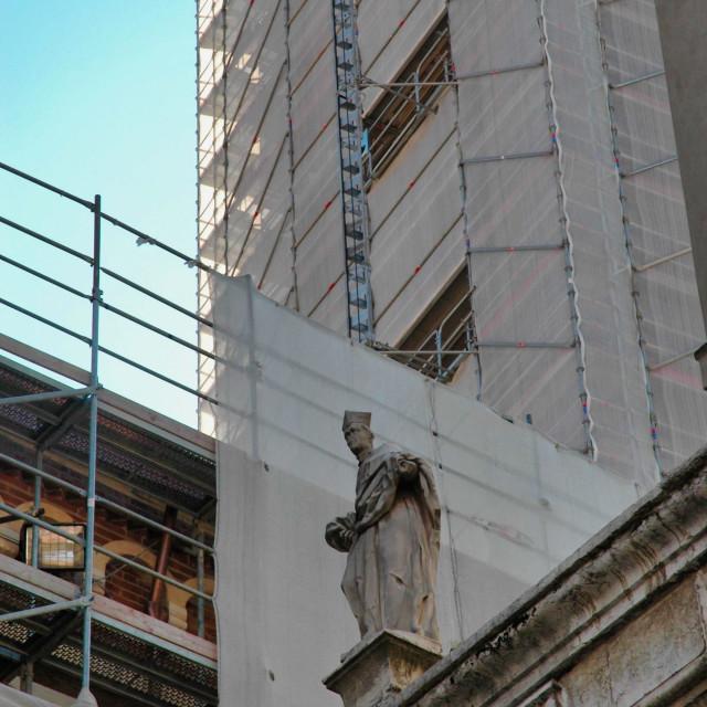 """Statue & construction"" stock image"