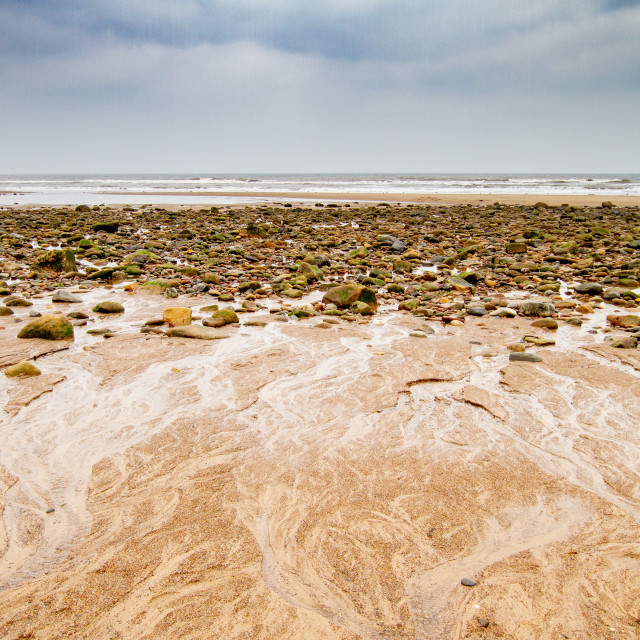 """Sandsend, Yorkshire, England. Looking across the beach towards the North Sea."" stock image"
