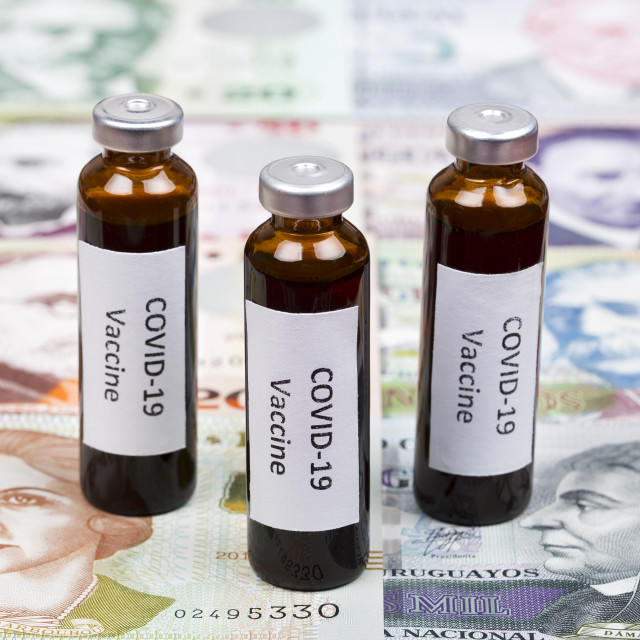 """Vaccine against Covid-19 on the background of Uruguayan peso"" stock image"