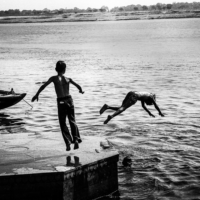 """Boy Diving, Varanasi, India"" stock image"