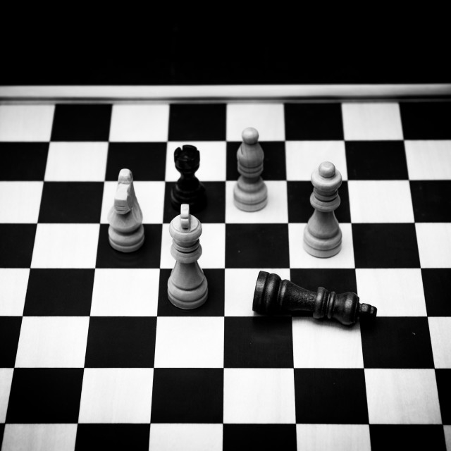 """""""Chess board with pieces and checkmate concept retro old fashione"""" stock image"""
