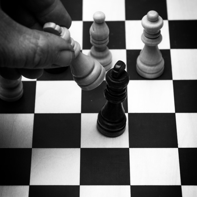 """""""End of game concept checkmate human hand on chess board"""" stock image"""