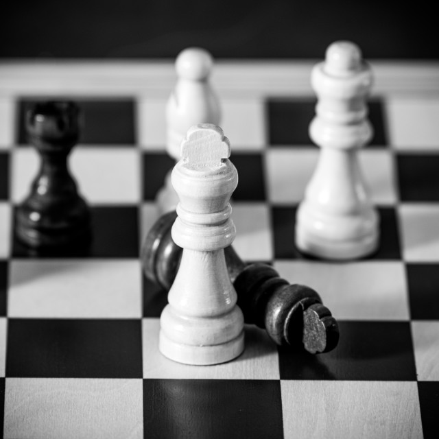 """""""End of game concept checkmate black king down extreme close up s"""" stock image"""