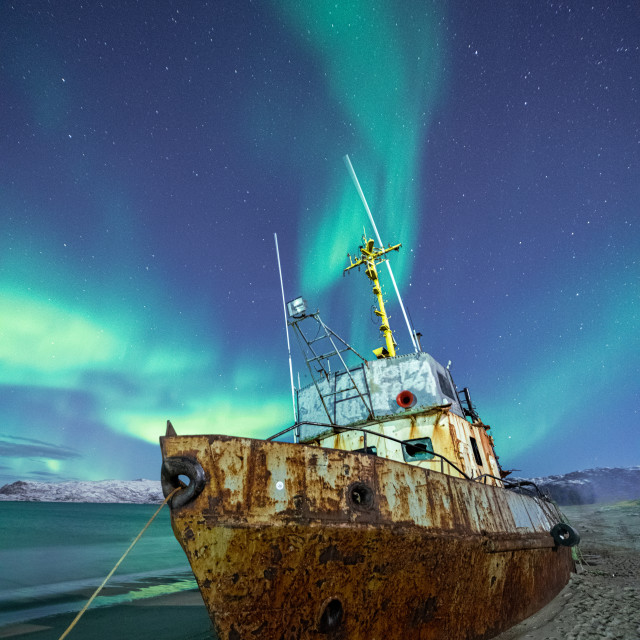 """""""Rusty boat under Northern lights"""" stock image"""