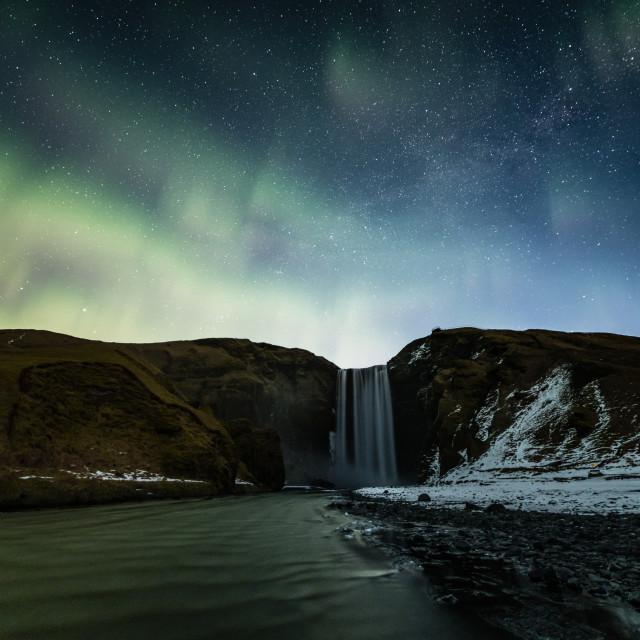 """Skogafoss with faint northern lights"" stock image"