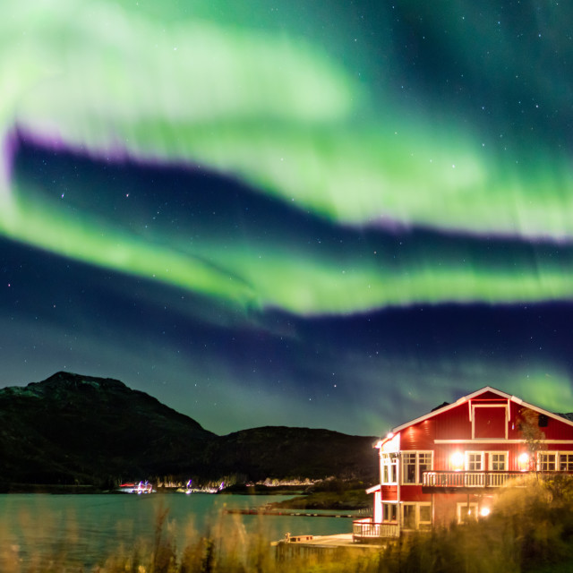 """""""Panorama with Northern lights over a red house"""" stock image"""