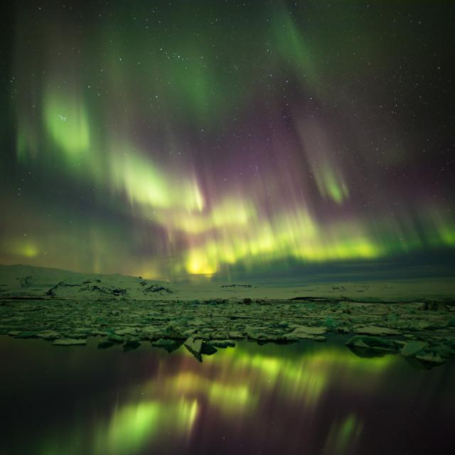 """Jokulsarlon glacier lagoon with Northern lights"" stock image"