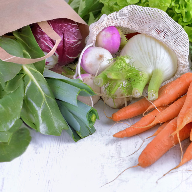 """""""vegetables in a reusable and paper bags among other fresh vege"""" stock image"""