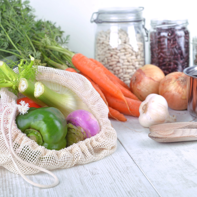 """""""fresh vegetables in a reusable bag and dry bean in jar with o"""" stock image"""