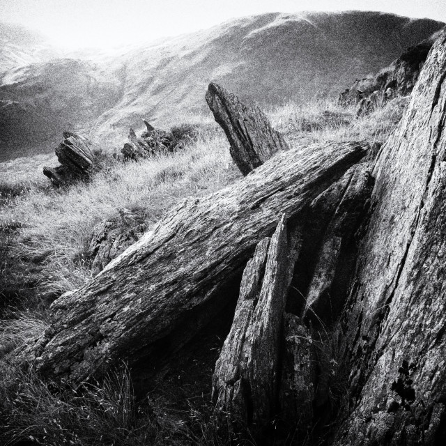"""Rocky mountain tops; Lake District National Park Monochrome Landscape"" stock image"