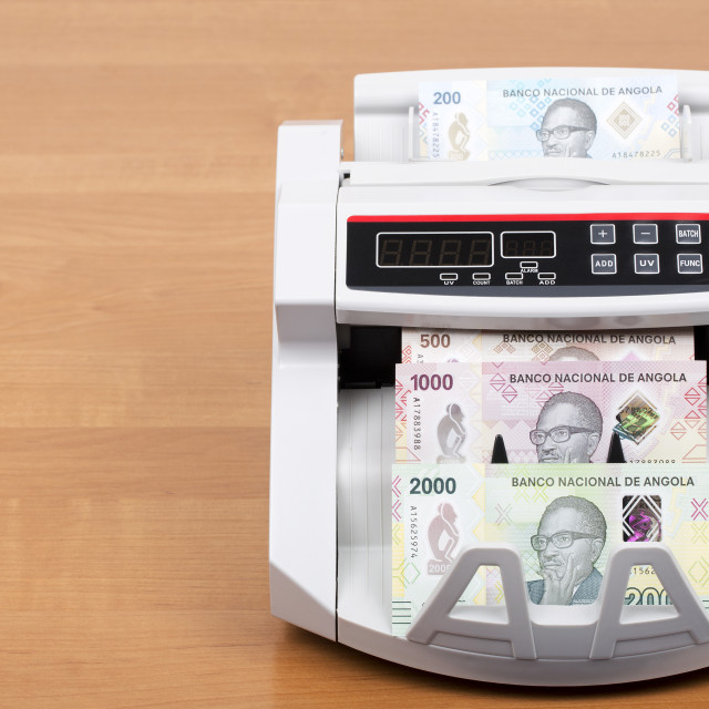 """Angolan money a new series of banknotes in the counting machine"" stock image"