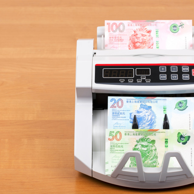 """Hong Kong Dollar in the counting machine"" stock image"