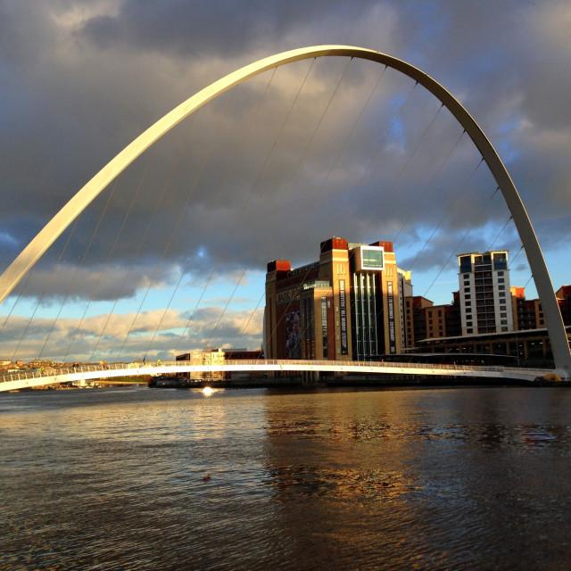 """Gateshead Millennium Bridge, River Tyne & The Baltic Flour Mills."" stock image"