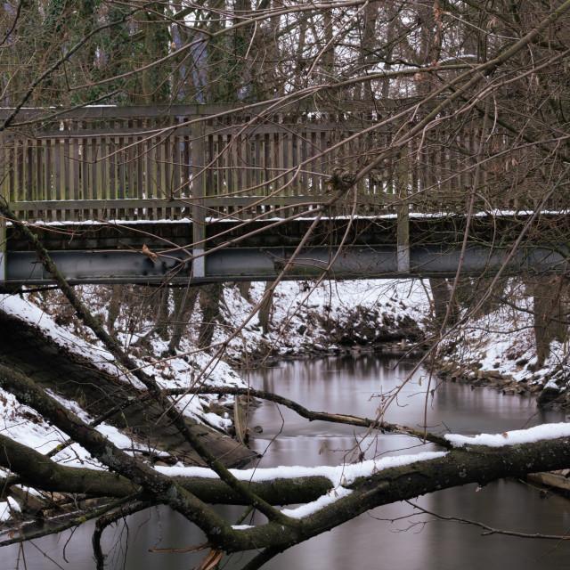 """A bridge over a stream"" stock image"