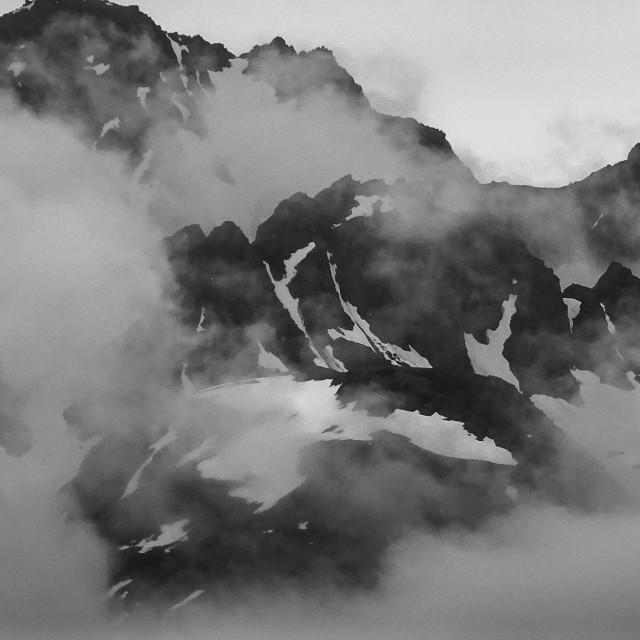 """Mountain peaks south of Turnagain Arm, Alaska - monochrome"" stock image"