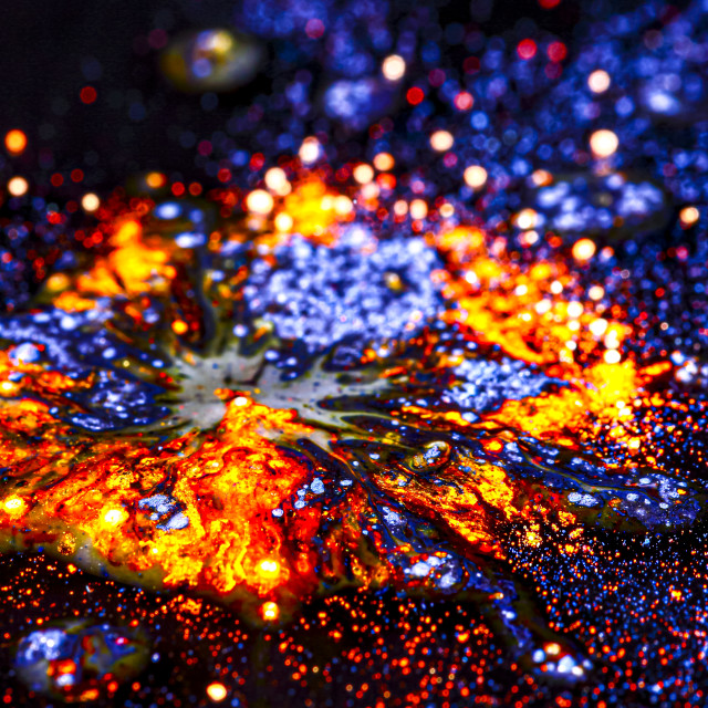 """""""Powdered dye mixed with water to create a multi coloured glittery vibrant background"""" stock image"""