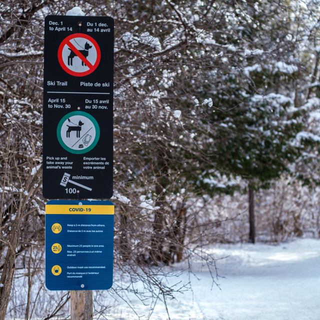 """""""COVID-19 signage on NCC trail in Ottawa wintertime"""" stock image"""