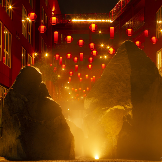 """Chinese lanterns behind rocks and mist"" stock image"