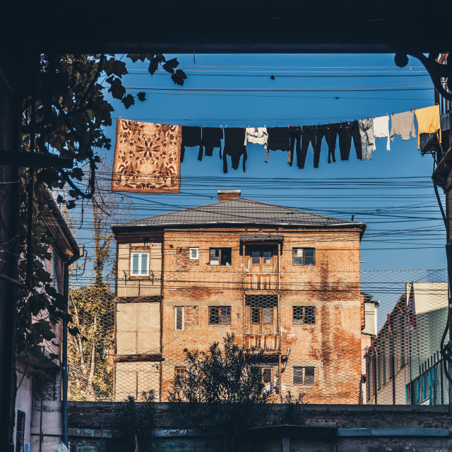 """""""Laundry drying in the yard of a traditional house"""" stock image"""