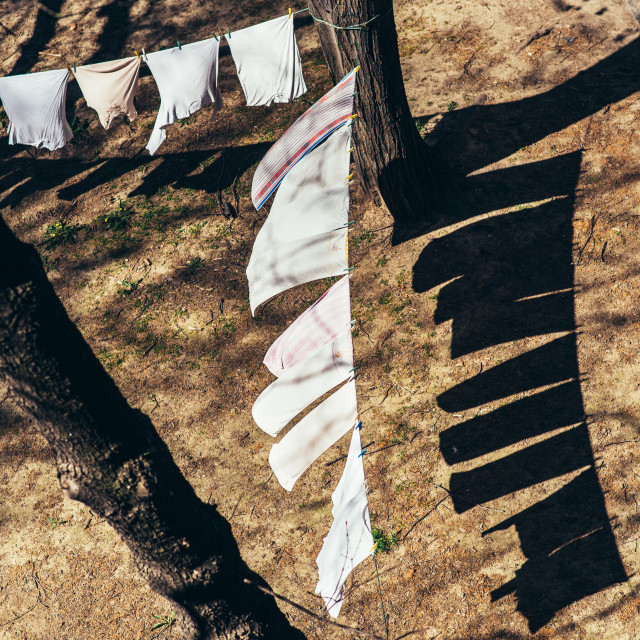 """""""Laundry hanging on a wire, drying on a windy and sunny day"""" stock image"""