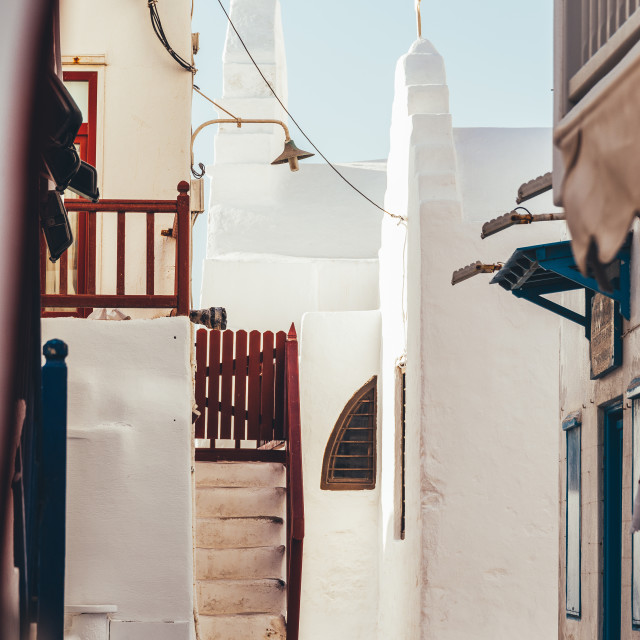 """""""Greek island of Mykonos, old town narrow streets, white buildings and colorful terraces"""" stock image"""