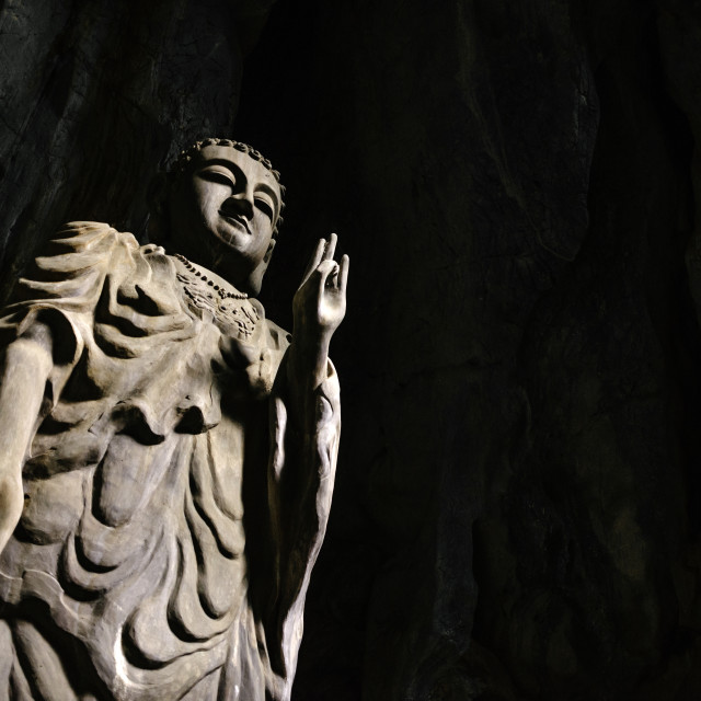"""""""Buddha statue in a cave of a Marble mountain in Da Nang Vietnam"""" stock image"""