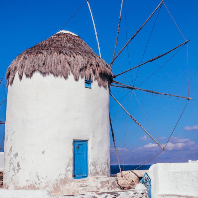 """Greek island of Mykonos wind mills on a blue sky sunny summer day"" stock image"